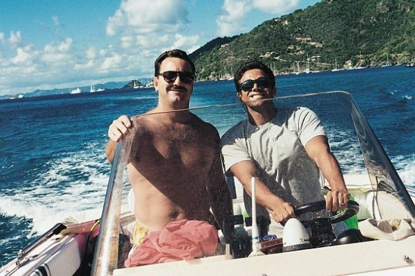 Fraudster, Jordan Belfort (R) at the wheel of his speedboat off
