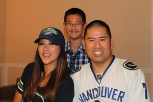 Clay with his son Sean and Marie Hui