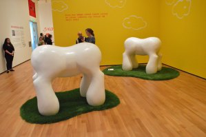 "Three of these molar-like, painted fiberglass ""50-Foot-Tall Scale Models of Proposed Farewell Arches to Luxembourg City"" rule patches of artificial grass at the Akron Art Museum. PHOTO 