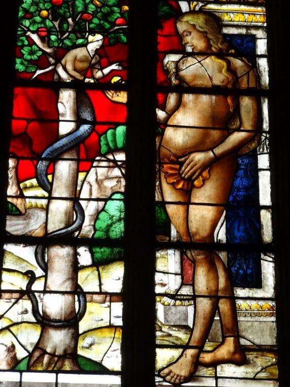 Eva y la serpiente. Detalle de la vidriera de la capilla del Purgatorio
