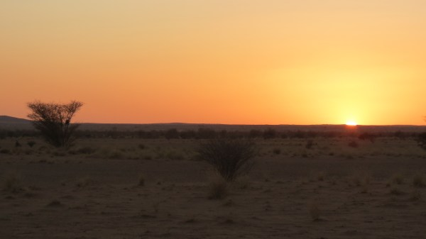 The sun sets on the Sahara, and on our tour of Sudan