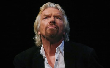 Sir Richard Branson listens to a speaker at the Global Commission on Drug Policy in New York, in this September 9, 2014 file photo. The former chief executive of Norwegian Cruise Line Holdings Ltd sued Branson's Virgin Group in federal court in Miami for $300 million March 11, 2014 over plans by the British billionaire to launch his own luxury cruise line.  REUTERS/Shannon Stapleton/Files (UNITED STATES - Tags: SOCIETY BUSINESS MARITIME)