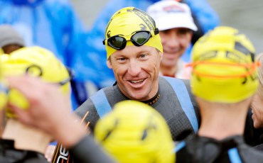 """Lance Armstrong talks to other members of the """"Survivors"""" group before they start the Ulman Cancer Fund For Young Adults Half Full Triathlon at Centennial Park on Sunday morning."""