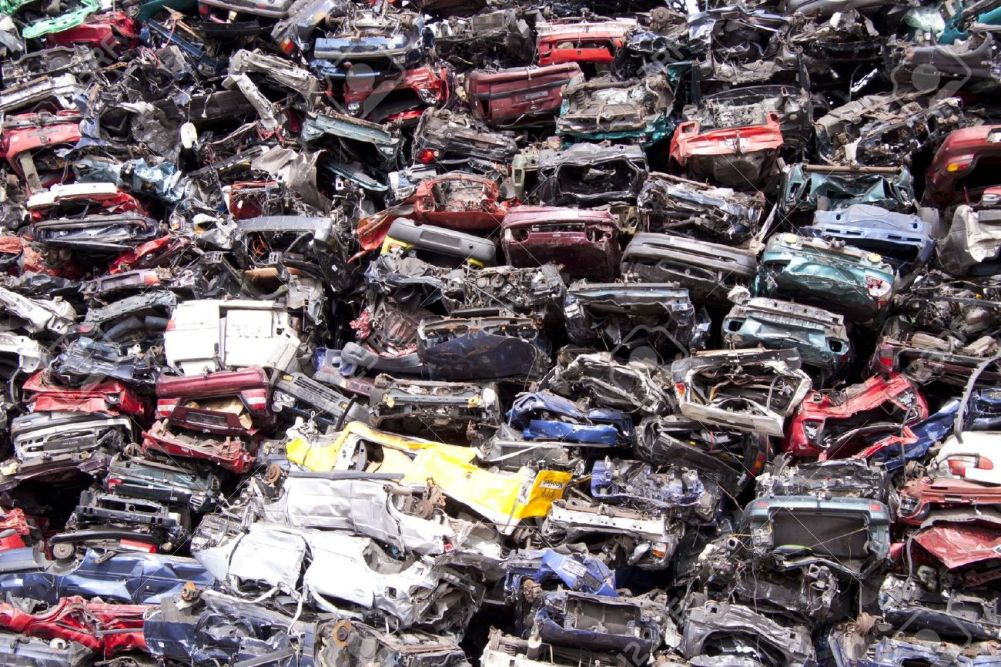 13118171-Lots-of-old-cars-on-a-pile-of-scrap-Stock-Photo-car