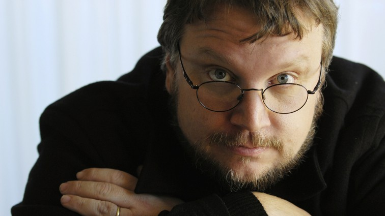 "Guillermo Del Toro poses in Beverly Hills, California, in this December 18, 2006 file photo. The filmmaker who was directing two movies based on J.R.R. Tolkien's ""The Hobbit"" has stepped down after two years on the project amid studio delays and schedule conflicts. REUTERS/Chris Pizzello/Files  (UNITED STATES - Tags: ENTERTAINMENT PROFILE)"