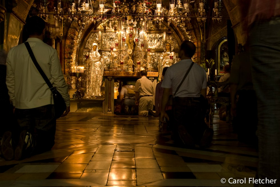 Kneeling at Calvary (in the Holy Sepulchre)
