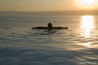 Bryan in the infinity pool overlooking the Dead Sea
