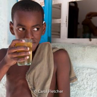 juice vendor boy street havana cuba