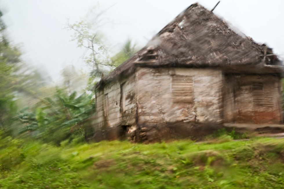 Cuba, thatched roof home on the knoll