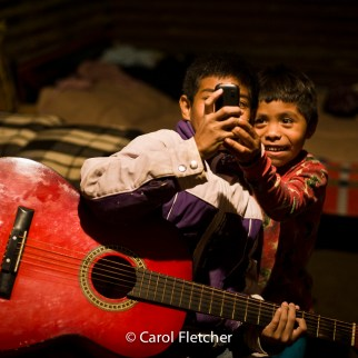 Guatemala boys guitar phone night duenas