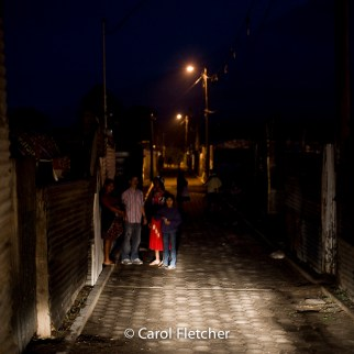 Guatemala night streetlight village poverty