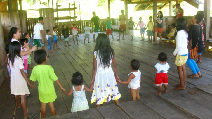 Higaonon young learners enjoy freely moving around their tribal house as part of the workshop facilitated by Cartwheel Team members