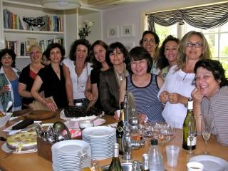 International gathering in the kitchen at Casa Caesarea