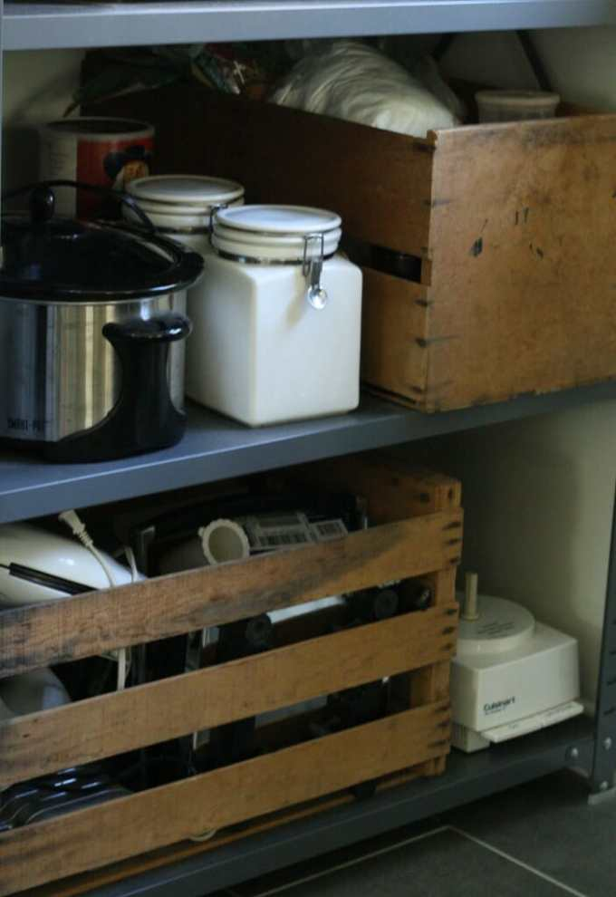 industrial shelf and crates for storage in kitchen