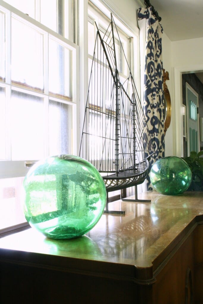 Green Glass Floats on Sideboard