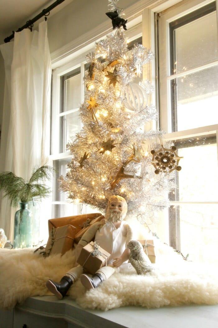 Tinsel tree with vintage Santa in dining room