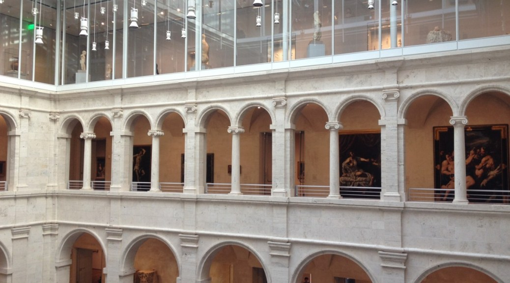 view of the classical courtyard of the Harvard Art Museums, topped by a modern third floor