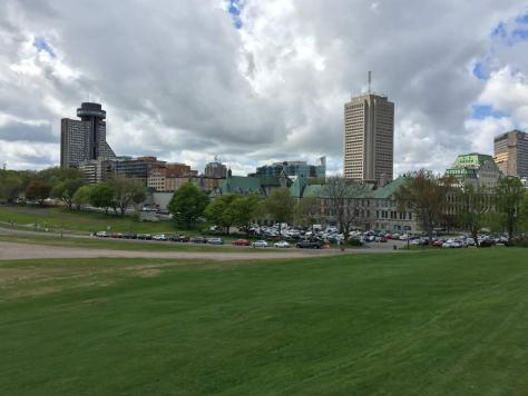 view onto Marie-Guyart Building (tall building on the right) and Hôtel Le Concorde Québec with a round disk of the rotating restaurant on top (on the left) from the Plains of Abraham