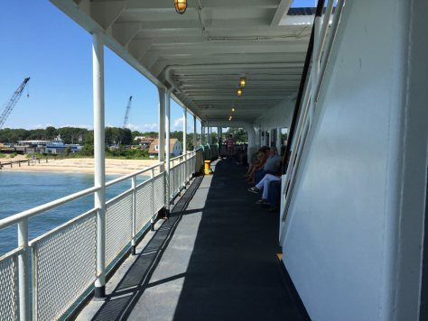 both sides of the middle level of the ferry have benches where you can sit down to enjoy the view