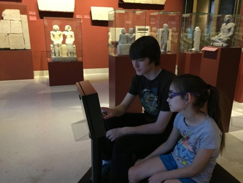 kids playing with the interactive tool allowing them to explore the interior of an Egyptian pyramid