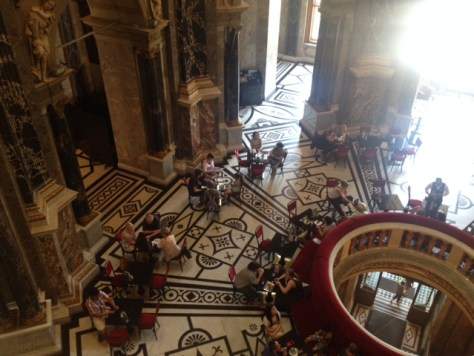 view from the third floor down to the cafeteria in the Cupola Hall
