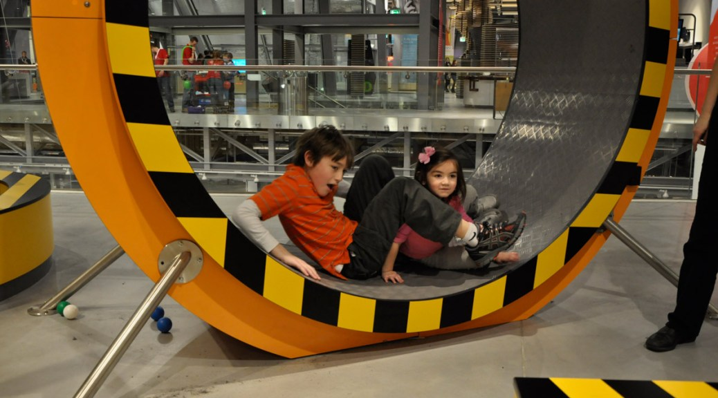 Having a lot of fun in the human size hamster wheel at the Copernicus Science Centre in Warszawa, Poland in 2011