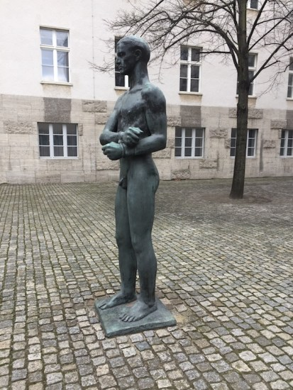 bronze figure of a young man with his hands bound, created by Richard Scheibe in the courtyard of the German Resistance Memorial Center