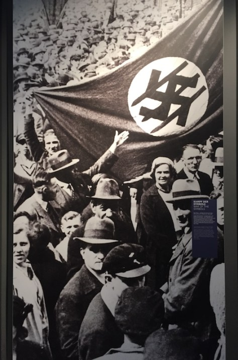 photo of an Iron Front demonstration with a flag of their symbol - Three Arrows (across the Nazi swastika)