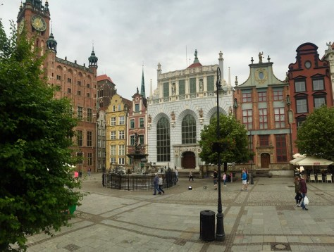 Długi Targ = the Long Market place with Neptune Fountain and City Hall on the left in Gdańsk, Poland