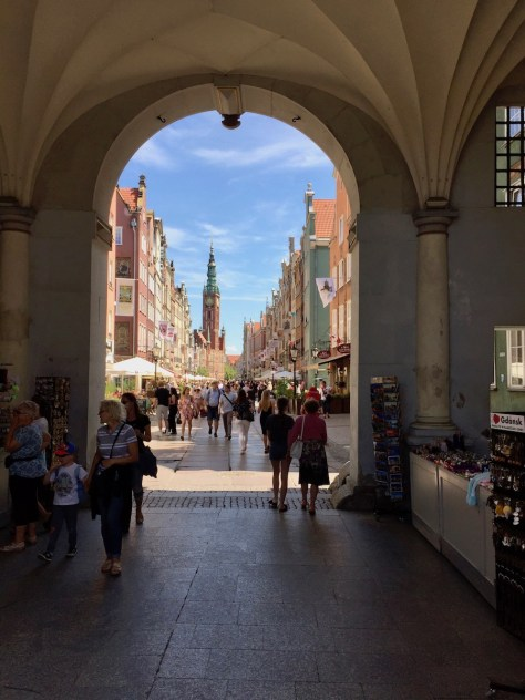 view onto Długa (Long) Street and Gdańsk Town Hall in the distance from Złota Brama (Golden Gate).