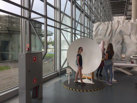 learning how acoustic mirrors work at the Experiment Science Centre (Centrum Nauki Experyment) in Gdynia, Poland