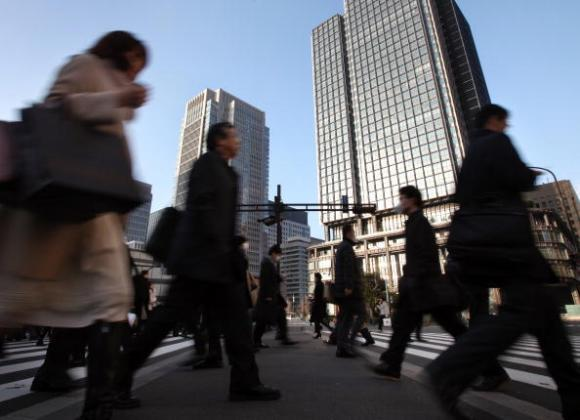 Morning commuters make their way to work in the central business district of Tokyo, Japan, on Friday, Dec. 25, 2009. Japan's unemployment rate rose for the first time in four months in November, an indication job growth may not be strong enough to support the economy's recovery from its deepest postwar recession. Photographer: Tomohiro Ohsumi/Bloomberg via Getty Images
