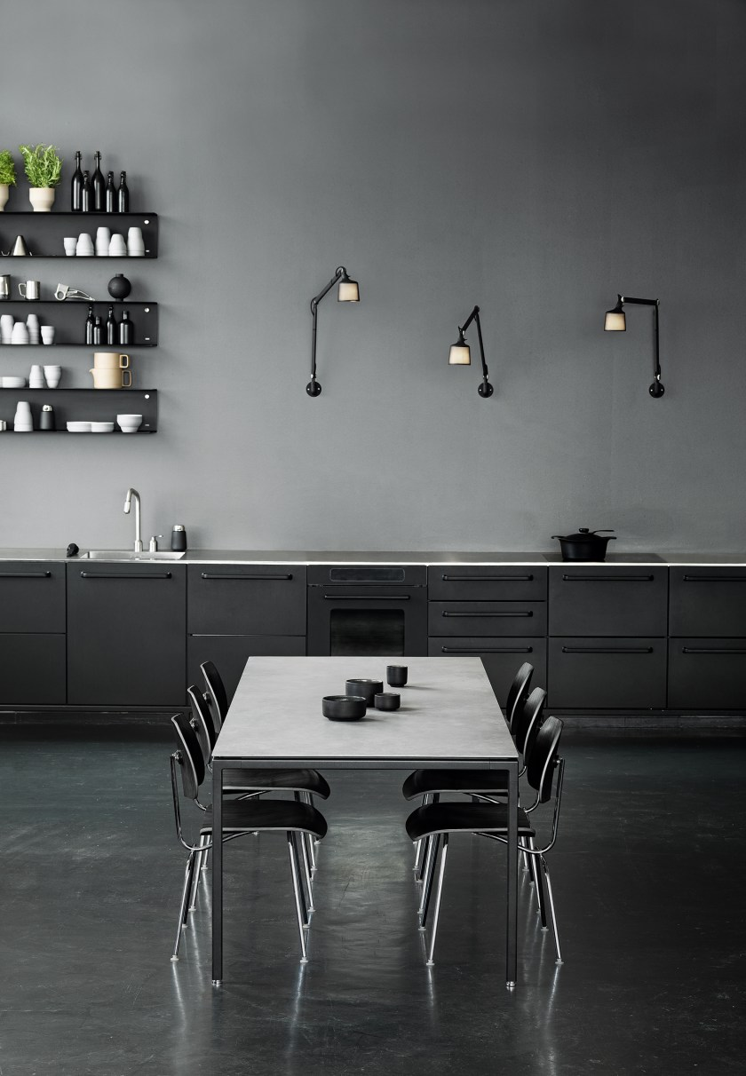 Vipp dining table in a monochrome minimalist interior