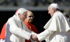 Pope Francis, right, greets Pope Emeritus Benedict XVI at the end of a meeting with elderly faithful in St. Peter's Square at the Vatican, Sunday, Sept. 28, 2014. (AP Photo/Gregorio Borgia)