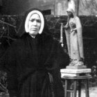 Sister Lucy with Fr. McGlynn's Statue
