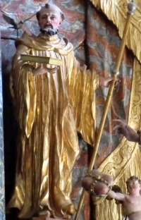statue of Saint Findanus von Rheinau with a dove and his pilgrim's staff; artist unknown; high altar, monastery church, Rheinau, Switzerland