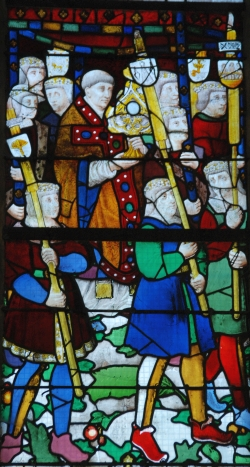stained glass window depicting the procession of the drapers in the early 16th century; date and artist unknown; south nave aisle, Church of Notre-Dame de Louviers, Eure, France; photographed on 8 March 2015 by Kgsweene; swiped from Wikimedia Commons; click for source image