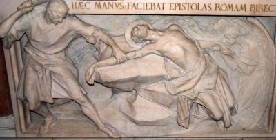 bas-relief of the martyrdom of Saint Arialdus of Milan, date unknown, artist unknown; San Calimero church, Milan, Italy; photographed on 5 May 2007 by Giovanni Dall'Orto; swiped from Wikimedia Commons
