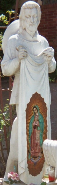 statue of Saint Juan Diego; date and artist unknown; in front of Saint Teresa of Avila Catholic Church, Echo Park, Los Angeles, California; photographed on 8 July 2006 by Rockero; swiped from Wikimedia Commons; click for source image