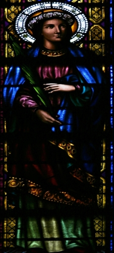 detail of a stained glass window of Saint Juliana of Mataró; date and artist unknown; interior of the Basílica of Santa Maria del Mar, Barcelona, Spain; photographed on 10 February 2014 by José Luiz Bernardes Ribeiro; swiped from Wikimedia Commons