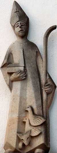 sandstone sculpture of the Saint Liudger; date and artist unknown; eastern facade of Recker Dionysius youth home, parish church of Saint Dionysius, Recke, North Rhine-Westphalia, Germany; photographed in July 2010 by J. H. Janßen; swiped from Wikimedia Commons