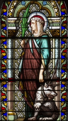 detail of a stained glass window of Saint Margaret of Antioch, date and artist unknown; church of Saint-Denis-de-la-Croix-Rousse in Lyon, France; photographed on 29 October 2015 by Xavier Caré; swiped from Wikimedia Commons