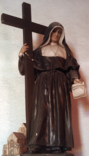 statue of Saint Marie-Madeleine Postel, date and artist unknown; Church of Saint-Mathurin, Guilberville, France; photographed on 18 November 2011 by Xfigpower; swiped from Wikimedia Commons