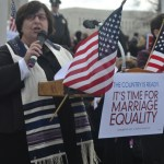 Rabbi Denise Eger speaking at the rally in Washington, DC.