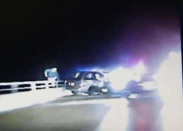 Michigan State Police Officer Falls Over Overpass