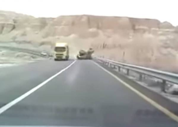 Tractor Falls Off Of Trailer