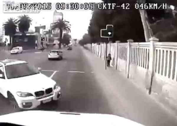 VIDEO: BMW Driver Hits Truck Head On, Sends Pedestrian Running
