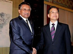 Wen Jiabao (R) shakes hands with  Pervez Musharraf in Beijing. PHOTO: REUTERS