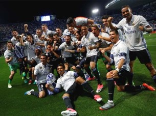 Real Madrid celebrate after winning La Liga at the La Rosaleda stadium in Malaga. PHOTO: REUTERS