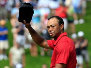 Tiger Woods of the United States acknowledges the crowd on the 18th hole during the final round of The Memorial Tournament. PHOTO: GETTY